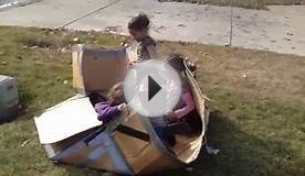 Kids playing with Cardboard box